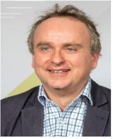 The speaker Nick Holland's profile image